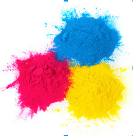 blue, yellow, and red toner powder in piles