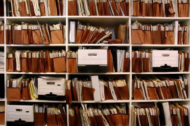 shelves with stacks of files