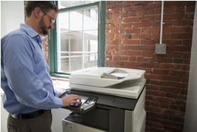 man using stand-up copier
