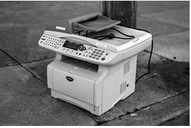 black and white image of copier on street corner