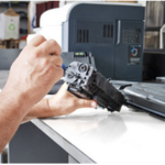 person repairing copier part