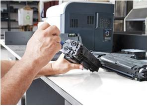 person repairing broken copier part